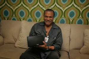 Billy Dee Williams holding Korus